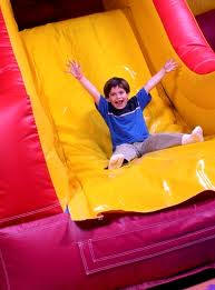 water slide boy bouncing